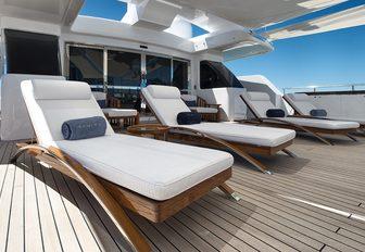Sunloungers on superyacht RARITY