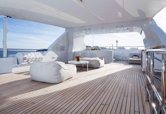 spacious and chic sundeck with multiple lounging areas aboard charter yacht GO