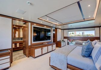 full-beam master suite with huge TV aboard superyacht Drew