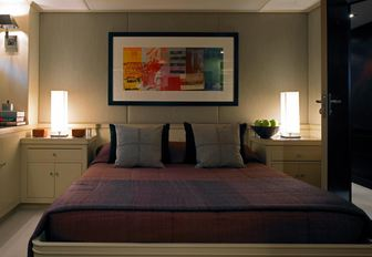 Double bed with lighting either side on Illusion I yacht