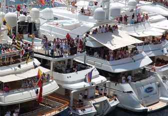 superyachts teaming with spectators at the Monaco Grand Prix