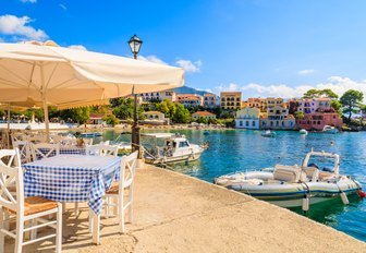restaurant on the scenic harbour of Assos village in Kefalonia, Greece