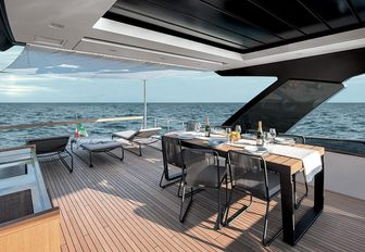the alfresco ding area on the main deck aft deck of charter yacht lucky