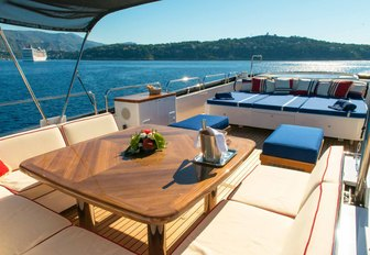 Sundeck of charter yacht ELEMENT, with dining area and jacuzzi in background