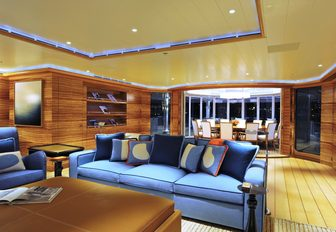 warm and welcoming upper lounge with Zebrano wood on board luxury yacht TV