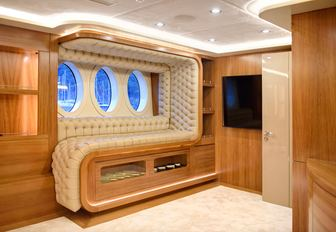 Comfy seating built into wall on superyacht ARESTEAS