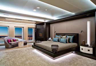 sensuous master suite with full-length windows on board motor yacht Mogambo