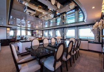 formal dining area in the main salon of charter yacht DIANE