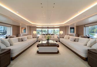 Open plan lightly colored interior on superyacht O'PARI