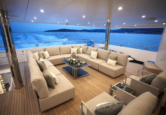 u-shaped seating area on the main deck aft of motor yacht ARADOS
