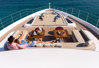 Charter guests gathered together on the foredeck of Gulf Craft superyacht ONEWORLD
