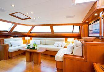 U-shaped sofa in the main salon of charter yacht RAPTURE