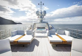 day beds on upper level of the sundeck aboard motor yacht 'Step One'