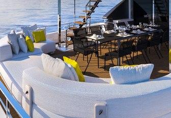 alfresco dining area on upper deck aft of motor yacht December Six