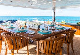 alfresco shaded dining area on superyacht