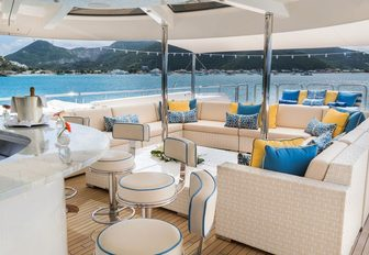 alfresco bar and seating area on the sundeck of luxury yacht TRENDING