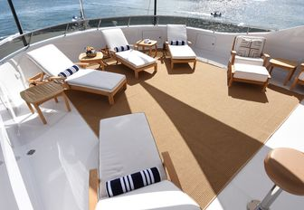 Sun loungers on foredeck of REBEL