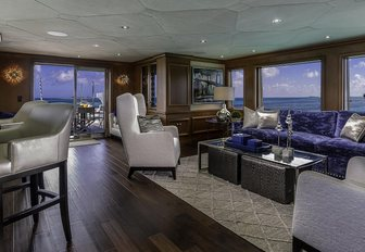 bar and seating area in the skylounge aboard motor yacht M3