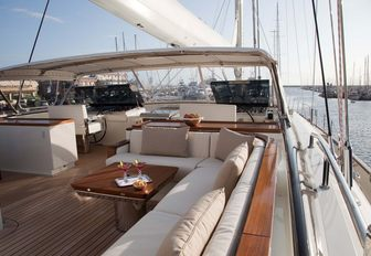 bridge deck seating area and helm on board charter yacht FIDELIS