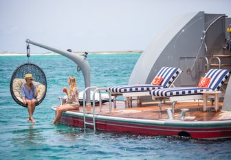 The swim platform and attached hammock seating on board M/Y Zoom Zoom Zoom