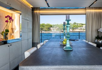 Covered dining table with doors open to balcony on motor yacht Cinquanta 50