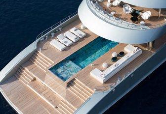 Luxury superyacht Savan at anchor with custom swimming pool