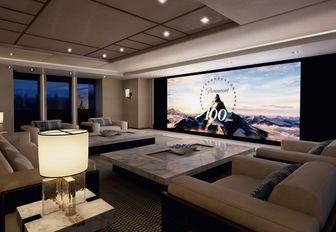 huge TV transforms salon into a cinema room aboard superyacht Illusion Plus