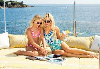 Charter guests enjoy the sunpads on luxury yacht My Seanna