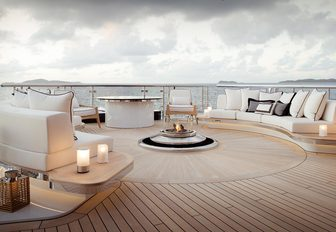outdoor seating surrounds a fire pit on board charter yacht KISMET