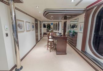 wood-clad bar forms part of the skylounge on board superyacht GLOBAL