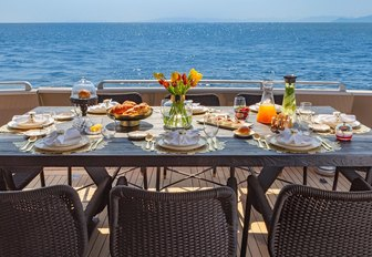 gorgeous banquet served one the alfresco dining table of luxury superyacht ANAMEL