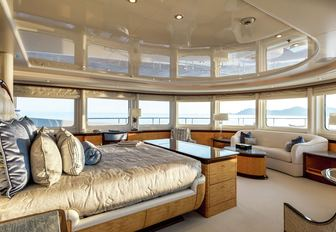 large bed and sofa in the master suite with 270-degree views aboard superyacht Lucky Lady