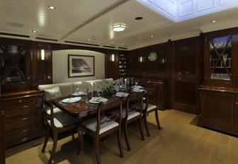 mahogany-clad dining salon on board sailing yacht RAINBOW