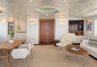 table and lounge area on board luxury yacht SENSES