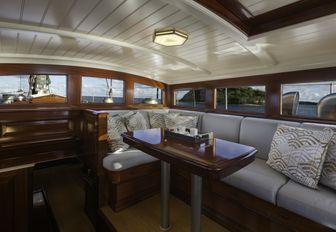 mahogany-clad salon on board charter yacht RAINBOW