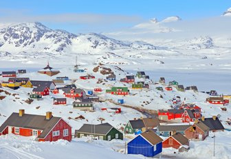 colourful houses surrounded by snow in Greenland