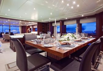 formal dining area in main salon of luxury yacht 'Pure Bliss'
