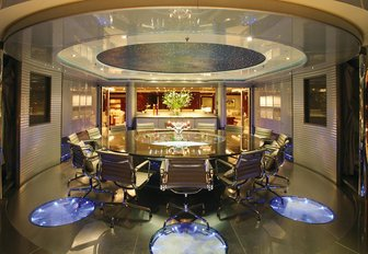 The lit up dining formal dining space on board superyacht 'Double Down'