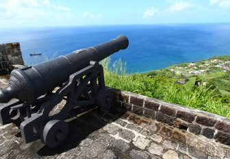 cannon looks out to see at the Brimstone Hill Fortress in St Kitts and Nevis