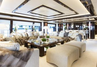 main salon with sumptuous seating on board luxury yacht ILLUSION V