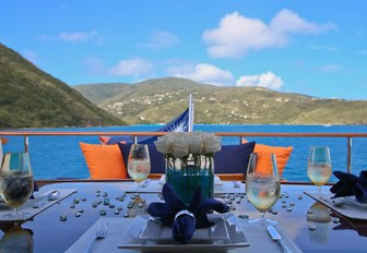 al fresco dining table on the sundeck of motor yacht M4 with views of the Bahamas