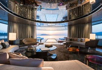 curved sofas and luxe styling in the main salon aboard charter yacht Savannah