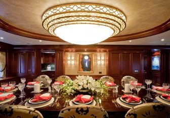 dinner is served in dining salon aboard charter yacht SOVEREIGN