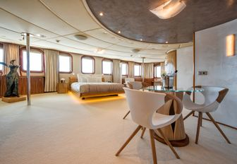 master cabin on charter yacht sherekhan, with seating area, statue and wide windows