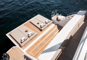 sunpads laid out on the fold-down swim platform of charter yacht Cheers 46