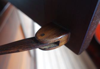 A carefully crafted wooden window hinge on luxury phinisi Dunia Baru