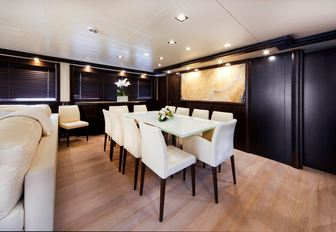Superyacht GATSBY dining area with table and dark walls