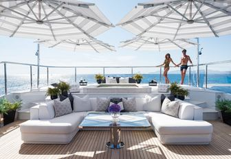 charter guests hangout by the Jacuzzi on the sundeck of luxury yacht 11/11