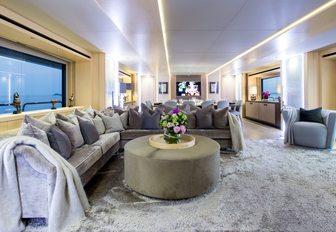 l-shaped sofa in stylish main salon on board superyacht BLUSH