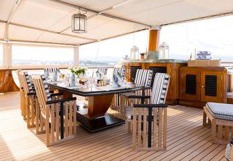 stylish alfresco dining area aboard superyacht TALITHA